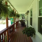 Enjoy the windchimes and water fountains from the antique porch swing