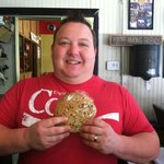Owner Joe Deel shows off a jumbo chocolate chip cookie!