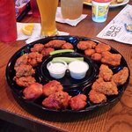 A dish of 25 boneless wings with five different flavors