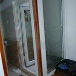 Wierd small shower with venetian blind inside it
