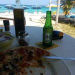 Pizza in front of the sea