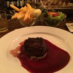 Filet of beef on a bed of blue cheese with strawberry sauce. Amazing!
