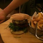 Whole Hog Burger - Go the whole hog with our homemade beef patty, bacon, smoked cheese,