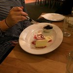 Raspberry & White Chocolate Cheesecake - A slice of delicious cheesecake, with berry coulis &