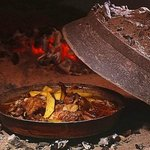 traditional Croatian food. veal with potatoes baked in fireplace. certainly try