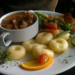 Delicious beef casserole with ring doughnut potatoes and vegetables.