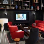 TV and fireplace area at citizenM