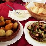Canaria potato and octopus in green sauce