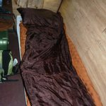 Train bed with a silk sleeping bag liner
