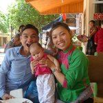 Our lovely guide Mao with a borrowed baby and a friend