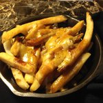Poutine...you have to try it...YUM