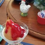 Poached pears with fresh homemade raspberry sauce.