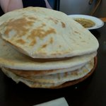 Freshly cooked naan breads. Soft and delicious