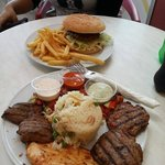 Beef burger with chips and Mix Plate Meat with Rice and Chips