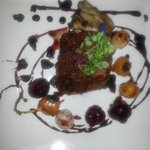 Main course of organic beef tenderloin, baby beets, roasted pearl onions and mushroom