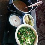 Side dishes that come with Bizar Bazar: Royal Persian Lamb, Tabouleh salad, yoghurt sauce & pick
