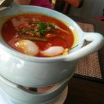 KAENG PHED PED YANG - Grilled duck in spicy red curry with fruit and coconut milk