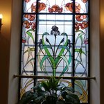 Beautiful Art Nouveau stained glass window at head of stairs