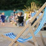 You can borrow blue and white striped deck chairs!