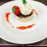 Rich Belgium chocolate tart, vanilla bean ice cream and sopley strawberry coulis