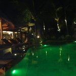 The pool and bar area by night