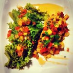 Grill chicken breast served with mango salsa and salad ....