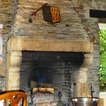 The beautiful fireplace in the dining room of Le Moulin de Via