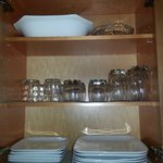 Cupboard filled with quality dishes
