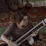 Me learning sitar