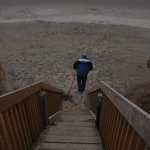 My husband entering the beach from the stairway.