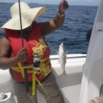 I dont have the pic yet of my dad catching his fish, but here's one of my mum :)