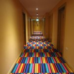 The colourfully carpeted hallway