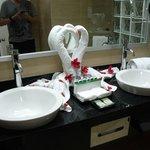 massive bathroom and beautiful towel arrangement.