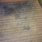 This is the carpet in front of the nightstand by the bed.