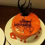 Anniversary cake delivered to our room by our butler