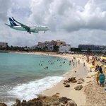 Plane lands at St. Maarten's airport.