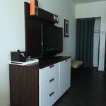Flat screen tv with mini-fridge hidden nicely below