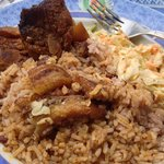 Delicious stew pork, rice, coleslaw and plantains - don't miss it!