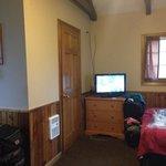 Bathroom door and TV in the housekeepig cabin
