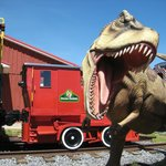 Dinosaur statue and caboose