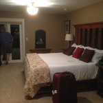 The king-sized bed, with the gas fireplace on the far wall, and the door out to the private balc