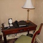Desk...convenient plugs for phone recharging...