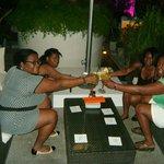 Having drinks near the pool