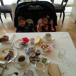 Yael and Yoav are enjoying the breakfast