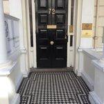 Front door - you get a key to front door with room key.