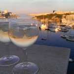 early evening drinks on the balcony overlooking Sliema harbour