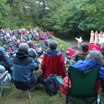 Summer performance in woodland amphitheatre