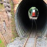 mini train going through tunnel