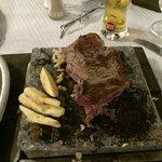 Steak on a stone at the buganvilla