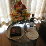 Special arrangement of Cake, wine and Flowers